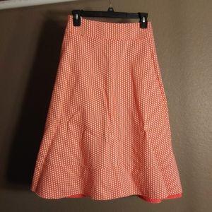 Orange and cream polka dot skirt